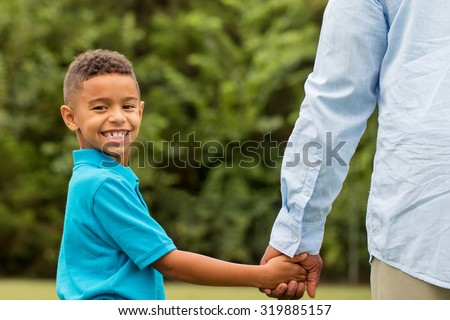 Young boy looking back at the camera. - stock photo