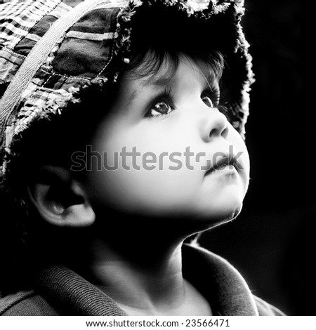 young boy looking up - stock photo