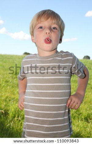 Young boy makes funny expression - stock photo