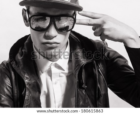 Young boy making cool face. Cool teenager.  - stock photo