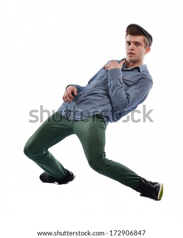 young boy man teen dancing and jumping isolated on white background in studio - stock photo