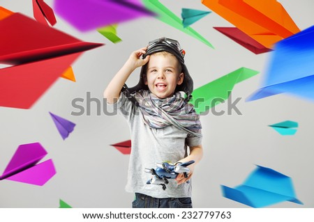 Young boy on paper airplane background - stock photo