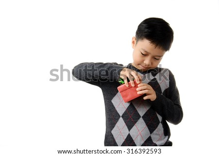 Young boy open gift box in his hand. Christmas and new year concept. - stock photo