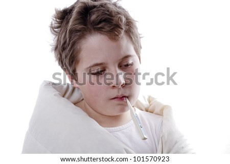 Young boy patient with fever, with digital thermometer and white blanketand flu - stock photo
