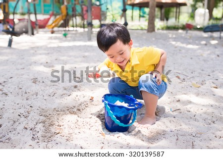 Young boy playing at playground. Outdoor activity. Adorable kid having fun at school yard - stock photo