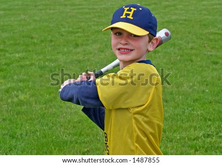 young boy playing baseball or t-ball - stock photo