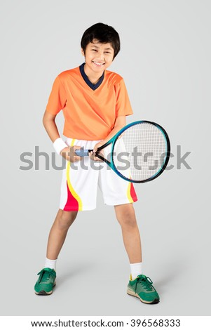 Young boy playing tennis, Isolated over white - stock photo
