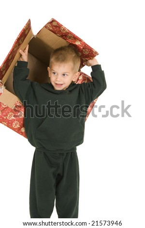 Young boy playing with empty Christmas box. Isolated on white. - stock photo