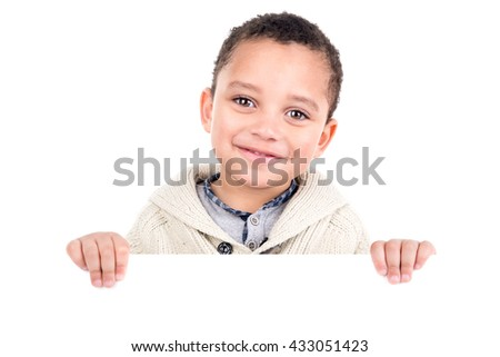Young boy posing with a white board - stock photo