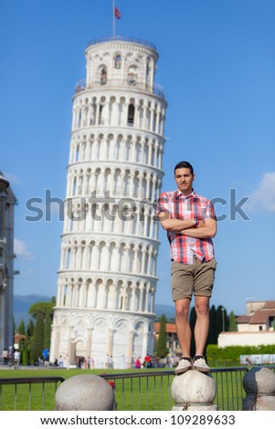 Young Boy Posing with Leaning Tower in Pisa - stock photo