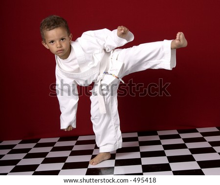 Young boy practicing martial arts - stock photo