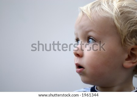 young boy profile against white - stock photo