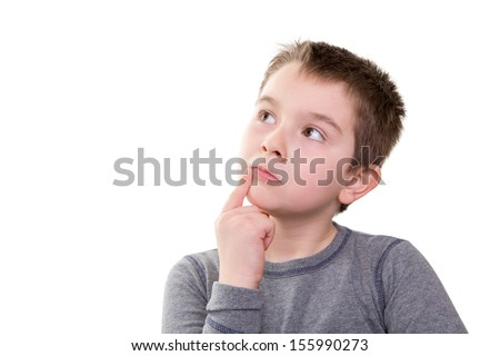 Young boy pushing the limits of his thought process, isolated on white - stock photo