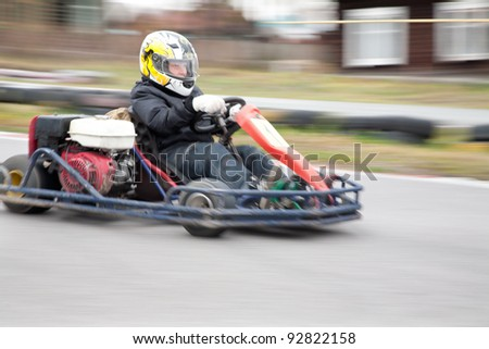 young boy raced on sport kart - stock photo