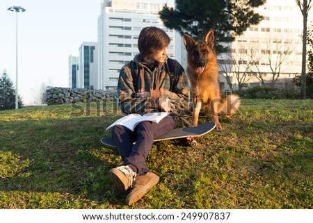 Young boy relaxing at the city park at the end of the day - stock photo