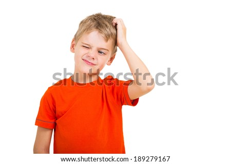 young boy scratching his head isolated on white - stock photo