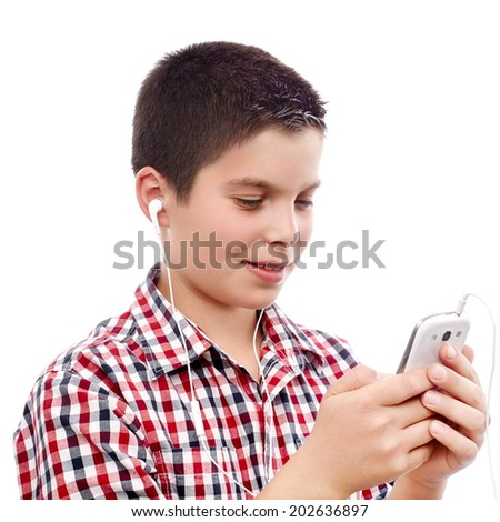 Young boy searching something on a smart phone - stock photo