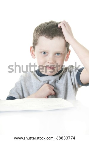 young boy showing stress with school work - stock photo