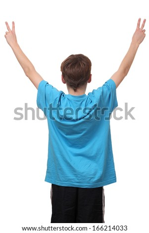 Young boy showing victory sign on white background - stock photo