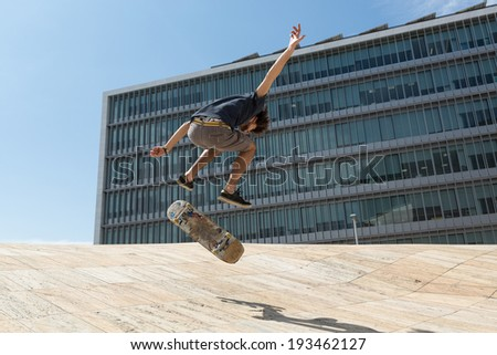 Young boy skateboarder at the local skatepark - stock photo