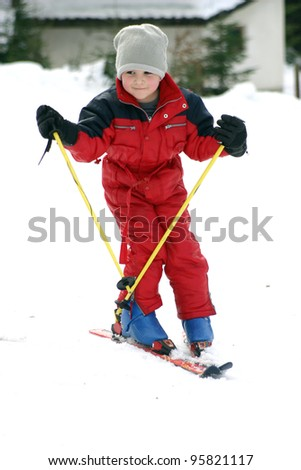 young boy skiing downhill - stock photo