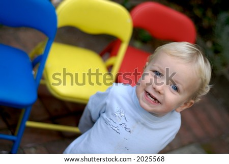 Young boy smiling with colorful background - stock photo