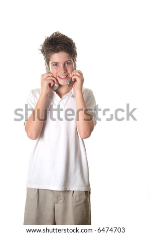 young boy talking on two cell phones full shot - stock photo