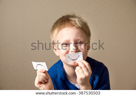 Young boy (teen) select between positive and negative expressions - stock photo