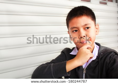 young boy thinking, thailand. - stock photo