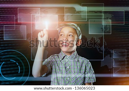 young boy touch virtual button in multicolored web inteface - stock photo