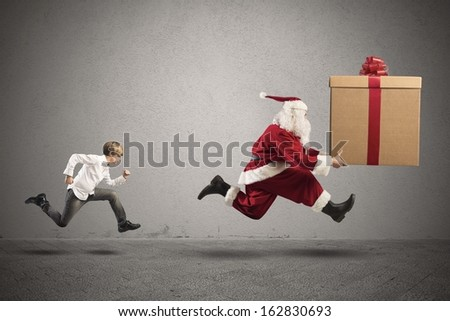 Young boy wants a present from Santa Claus - stock photo