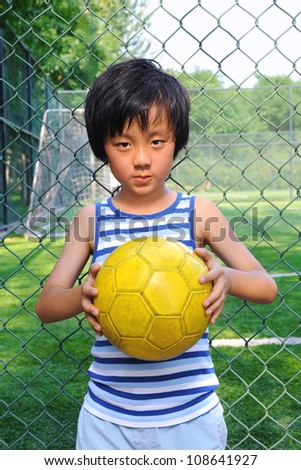 Young boy wants to play ball - stock photo
