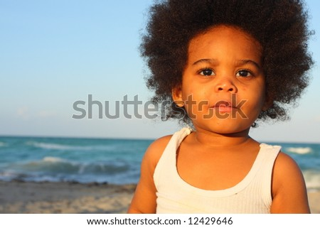 Young boy watching the sunset - stock photo