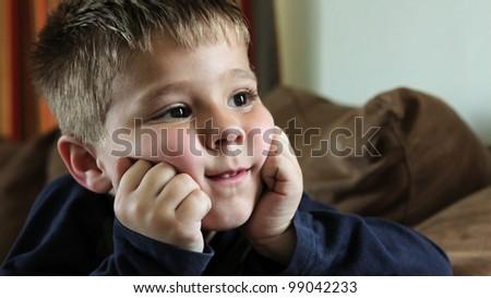 Young boy watching TV - stock photo