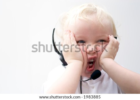 Young boy wearing phone headset - stock photo
