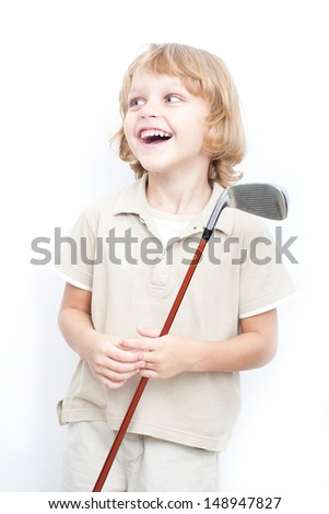 Young boy with  a golf club - stock photo