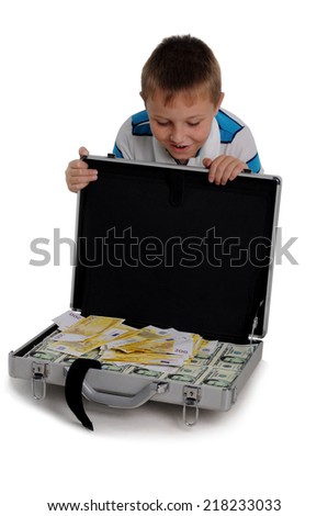 Young boy with a money briefcase - stock photo