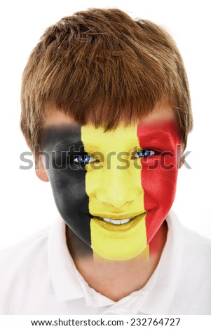 Young boy with Belgium flag painted on his face - stock photo
