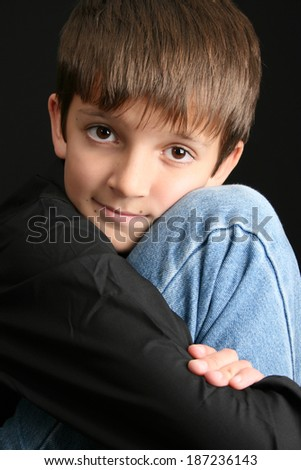 Young boy with big eyes in casual attire  - stock photo