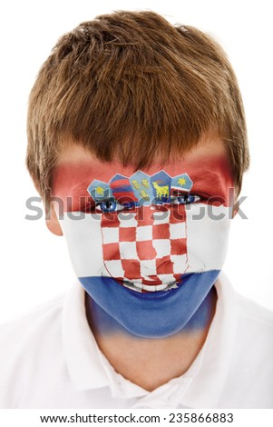 Young boy with croatia flag painted on his face - stock photo