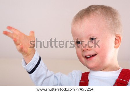 Young boy with Down Syndrome - stock photo