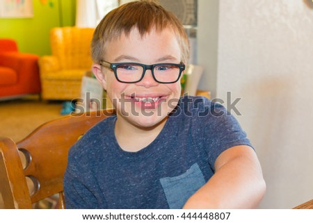 Young Boy With Downs Syndrome - stock photo