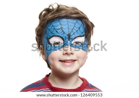 Young boy with face painting superhero smiling on white background - stock photo
