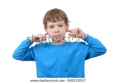 young boy with finger in ears isolated white background - stock photo