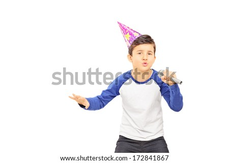 Young  boy with party hat singing on microphone isolated on white background - stock photo