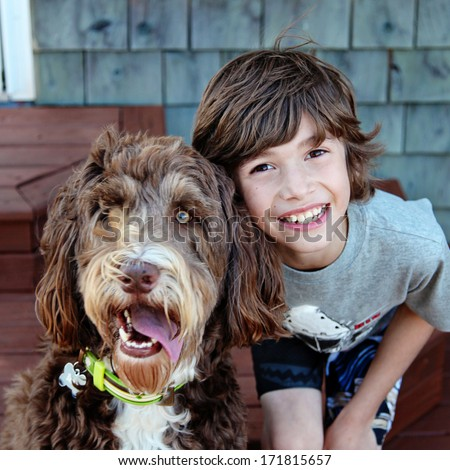 Young boy with Pet Dog closeup - stock photo