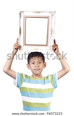young boy with photo frame in studio on white background - stock photo