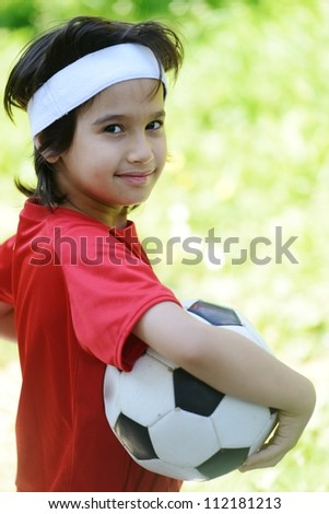 Young boy with soccer outdoor - stock photo
