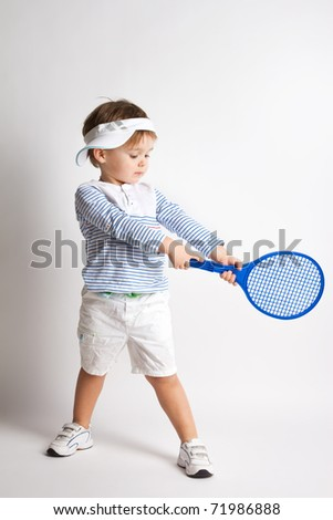 Young boy with tennis racket - stock photo