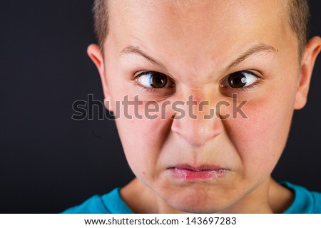 Young boy with the expression of a brat - stock photo